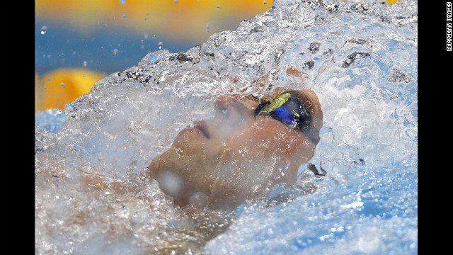 Nick Thoman of the United States competes in the men's 100-meter backstroke heat.
