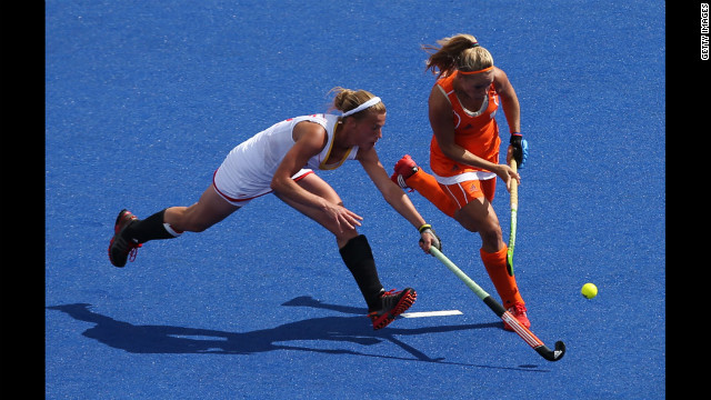 Belgium's Gaelle Valcke competes against the Kitty van Male of the Netherlands during a women's field hockey match.