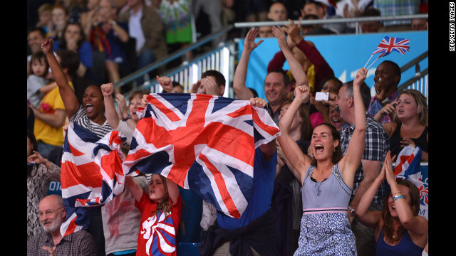 British fans cheer as Colin Oates of Great Britain defeats Tsagaanbaatar Khashbaatar of Mongolia in the men's under 66-kilogram judo match.
