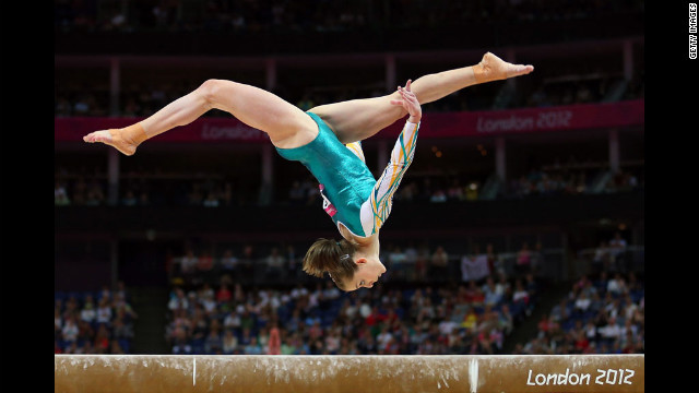Australia's Lauren Mitchell competes on the balance beam in the artistic gymnastics women's team qualification.