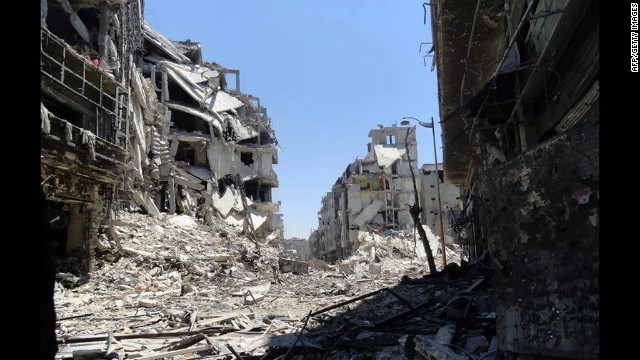 Destruction appears widespread in Homs on Friday, July 27, in<br />
