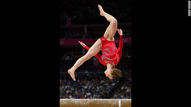 Great Britain's Jennifer Pinches shows her prowess on the beam in the artistic gymnastics women's team qualification round.