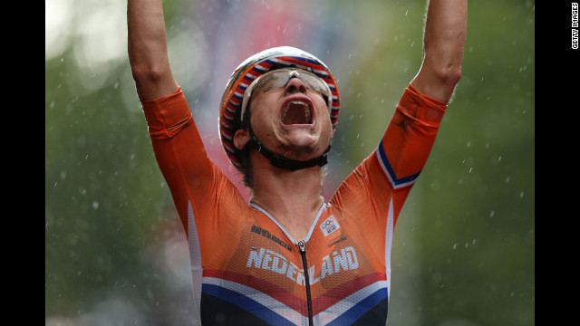 Marianne Vos of the Netherlands celebrates as she crosses the finish line to win the women's road race.