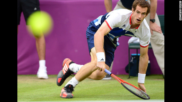 Andy Murray of Britain returns the ball against Stanislas Wawrinka of Switzerland during their men's singles tennis match.