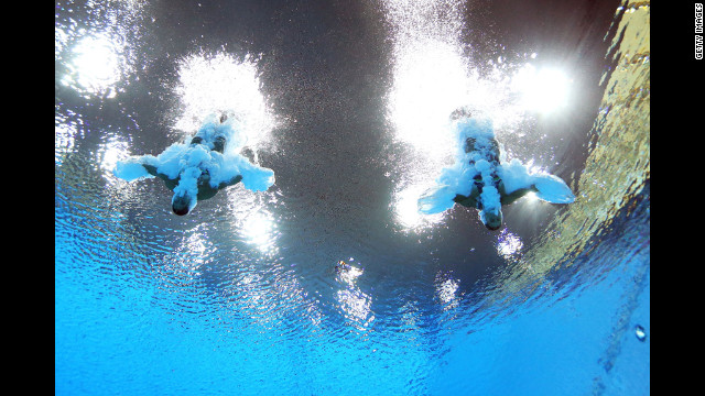 Francesca Dallape and Tania Cagnotto of Italy compete in the women's synchronized 3-meter springboard final at the Aquatics Centre.
