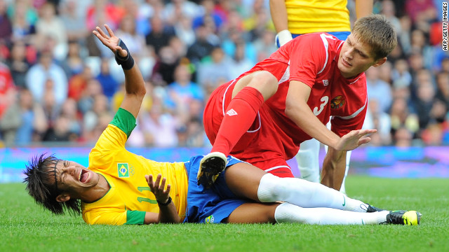 Neymar, left, of Brazil reacts during the men's football match with Belarus' Igor Kuzmenok in Manchester, England.