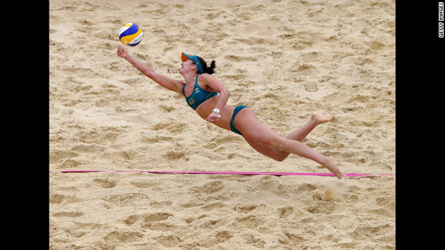 Becchara Palmer of Australia dives for the ball during a women's beach volleyball preliminary match against Germany.
