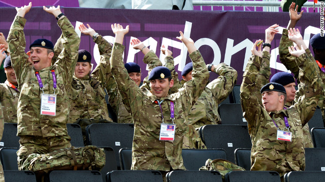 Ignoring both protocol and good sense, British soldiers perform the wave. They are currently imprisoned in the Tower of London and will be beheaded at dawn.