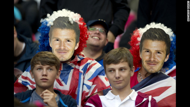 Football fans wear masks depicting David Beckham while waiting for the match between United Arab Emirates and Great Britain to begin at Wembley Stadium.