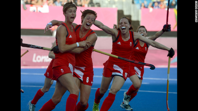 Britain's Sally Watson, left, is congratulated by teammates after scoring against Japan during the women's field hockey preliminary match.