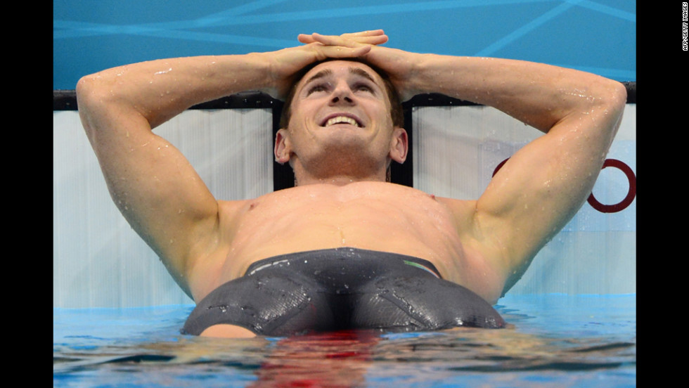 South Africa's Cameron Van der Burgh celebrates after breaking the world record in the men's 100-meter breaststroke at the London Olympics on Sunday, July 29. Check out <strong><a href='http://www.cnn.com/2012/07/28/worldsport/gallery/olympics-day-one/index.html'>Day 1 of competition</a></strong> from Saturday, July 28. The 2012 Summer Olympics ran through August 12.