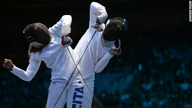 Italy's Rossella Fiamingo, left, faces off against Japan's Nakano Nozomi during the women's epee fencing match Monday. 
