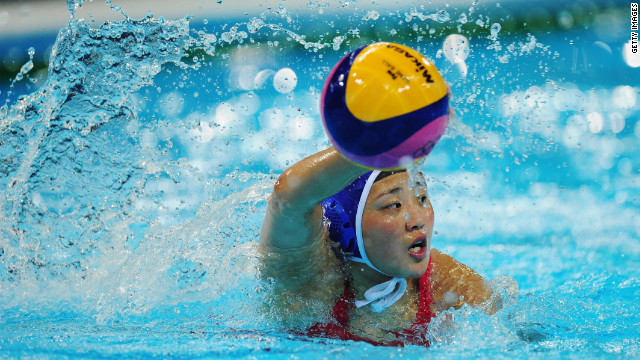 Yujun Sun of China looks to make a pass during the women's water polo preliminary match between Spain and China on Monday.