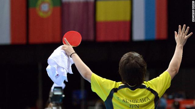 Seiya Kishikawa of Japan celebrates his victory over Panagiotis Gionis of Greece during the men's singles table tennis match Monday.