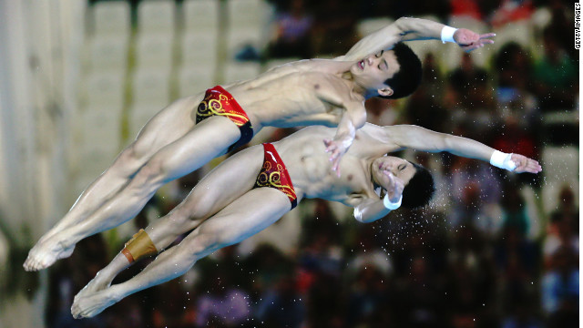 China's Yuan Cao and Yanquan Zhang on their way to gold in the 10m synchronized diving