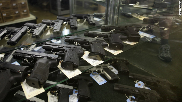Hand guns are displayed at a firing range July 22, 2012 in Aurora, Colorado.