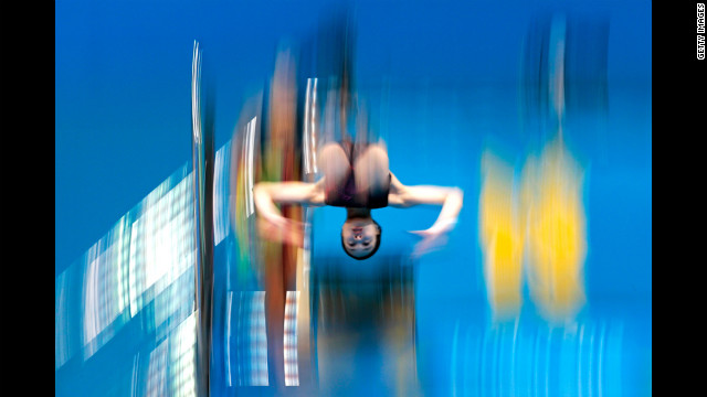 A female diver practices at the aquatics center on Monday.