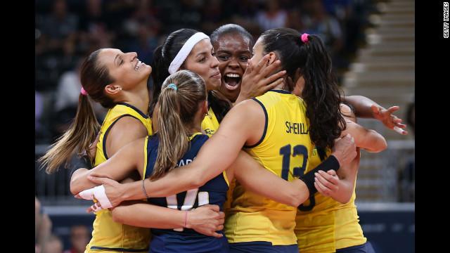 A Brazilian player celebrates winning a point in the women's volleyball preliminary match between the United States and Brazil on Monday.