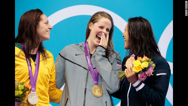 From left, silver medalist Emily Seebohm of Australia, gold medalist Missy Franklin of the United States and bronze medalist Aya Terakawa of Japan celebrate with their medals during the medal ceremony for the women's 100-meter backstroke on Monday.