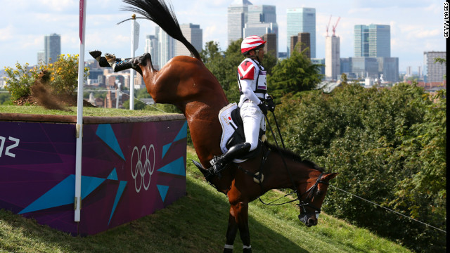 Atsushi Negishi of Japan, riding Pretty Darling, negotiates an obstacle in the eventing cross country equestrian competition.