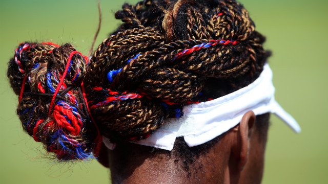 American Venus Williams incorporated her team colors into her hairstyle during her women's singles tennis second round match against Sara Errani of Italy.