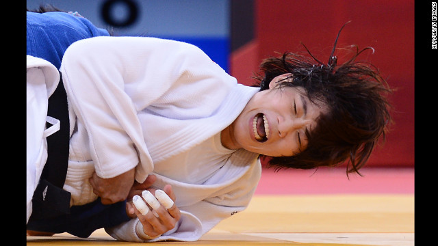 Korea's Jan-Di Kim, in white, takes on Mongolia's Sumiya Dorjsuren during the women's 57-kilogram judo contest on Monday. See <a href='http://www.cnn.com/2012/07/31/worldsport/gallery/olympics-day-four/index.html' target='_blank'>day four of the competition</a> from Tuesday, July 31.