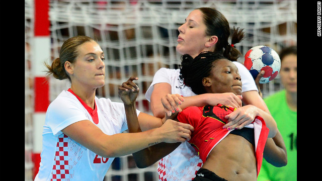 Angola's Isabel Fernandes, right, vies with Croatia's rightback Sonja Basic during the women's handball preliminaries match Monday.
