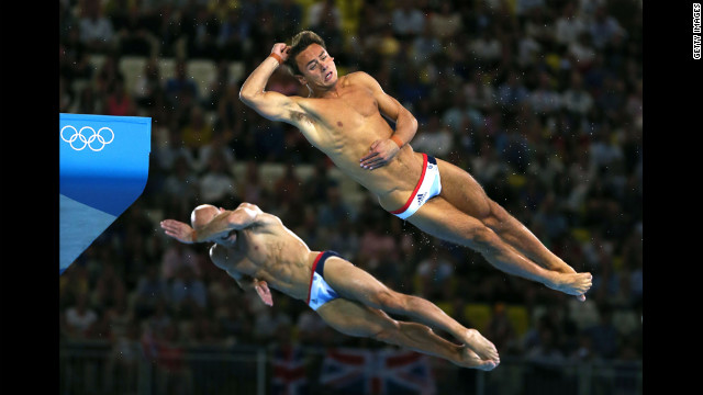 Remembering they're British, divers Tom Daley, right, and Peter Warfield are overcome with embarrassment.
