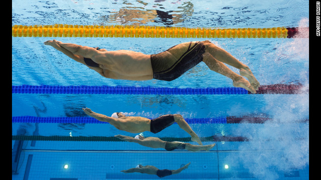 U.S. swimmer Nick Thoman, front, competes in the men's 100-meter backstroke semifinals.