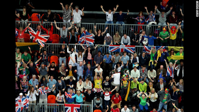 Fans of Great Britain cheer during the men's basketball game against Russia.