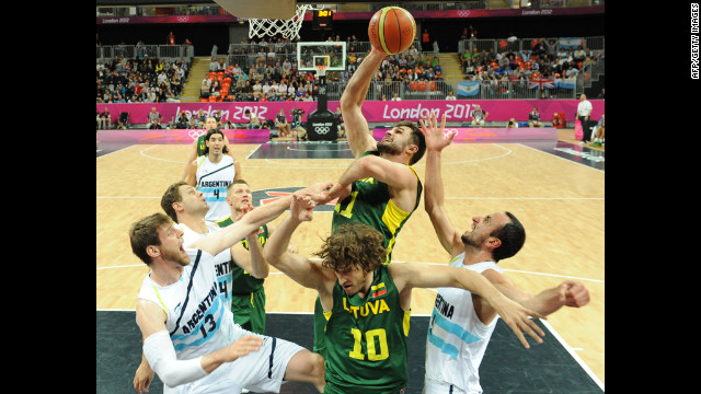 Lithuanian forward Linas Kleiza shoots during a preliminary basketball match against Argentina.