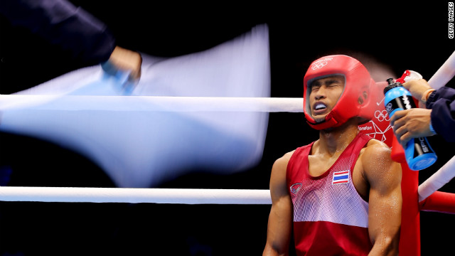 Chatchai Butdee of Thailand sits in his corner during his men's fly boxing bout with Selcuk Eker of Turkey on Monday, July 30, on Day 3 of the London 2012 Olympic Games. <a href='http://www.cnn.com/2012/07/29/worldsport/gallery/olympics-day-two/index.html' target='_blank'>Check out Day 2 </a>of competition from Sunday, July 29. The Games run through August 12. See all the action as it unfolds here.