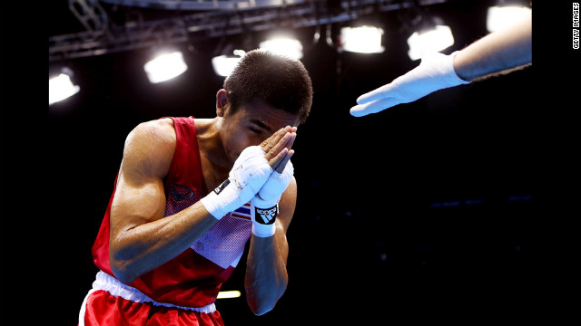 Chatchai Butdee of Thailand celebrates his victory over Selcuk Eker of Turkey during their men's fly boxing match.