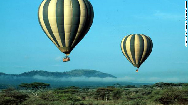 After bumping along the plains of the Serengeti at dawn, passengers take flight in balloons, where they can exercise their wildlife photography skills. 