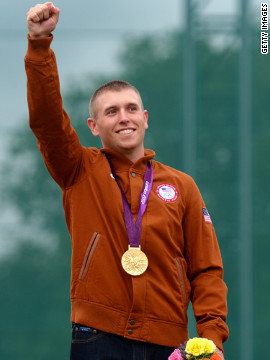 Vincent Hancock shows off his gold medal in men's skeet shooting Tuesday. 