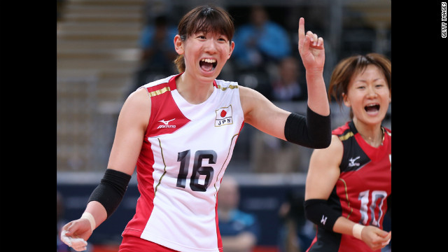 Yukiko Ebata of Japan celebrates winning a point in the women's volleyball preliminary match between Italy and Japan.