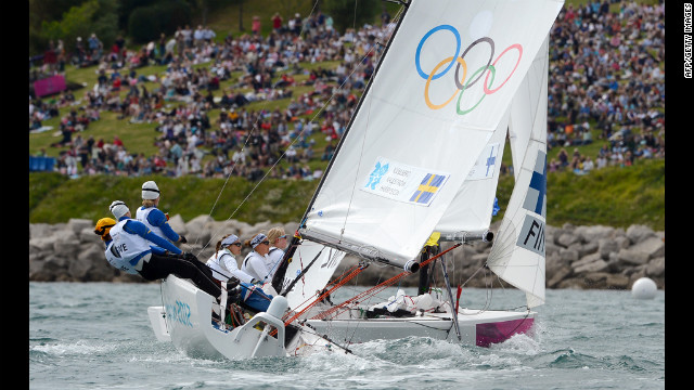 Britain's Andrew Simpson and Iain Percy round the mark in the star sailing class.