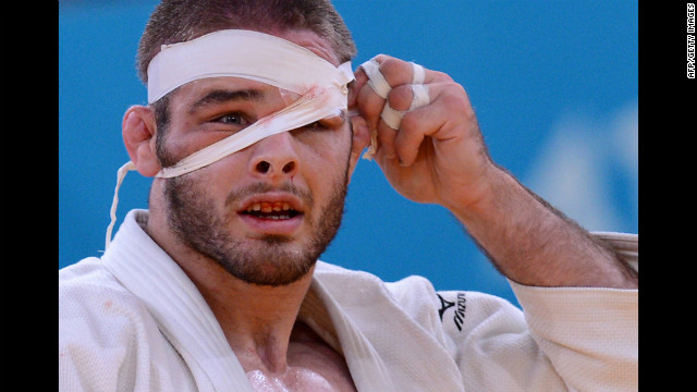 American Travis Stevens adjusts his bandage as he competes Tuesday during the men's under 81-kilogram judo semifinal match.