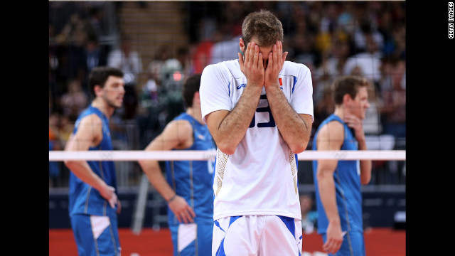 Italy's Dragan Travica reacts after the Italians won their men's volleyball match against Argentina.