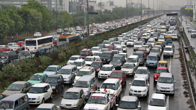 Heavy traffic backs up at a toll gate along a highway on the outskirts of New Delhi as power outages leave half of India without power Tuesday, July 31.