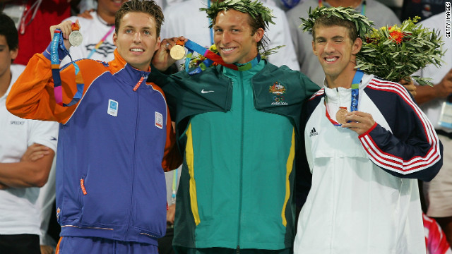 Gold medalist Ian Thorpe of Australia, silver medalist Pieter Van Den Hoogenband of the Netherlands (L) and bronze medalist Michael Phelps of USA (R) pose with their medals after the medal ceremony for the men's swimming 200 freestyle event in 2004. In total, Phelps won six gold and two bronze medals in Athens.