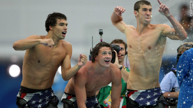 Not just an individual winner, but also a team player. Phelps shouts encouragement to Peter Vanderkaay (with fellow teammates Ricky Berens, Ryan Lochte) in the men's 4 x 200-meter freestyle relay final on Day 5 of the Beijing 2008 Olympic Games. The team won the race and set a new world record of 6:58.56.