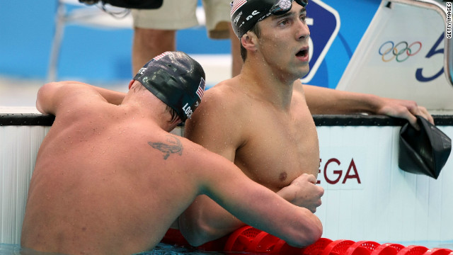 Fellow teammate Ryan Lochte hugs Phelps who seems in shock or just exhausted after win in the men's 200-meter individual medley final race in Beijing. Phelps won eight gold medals during the 2008 Summer Games.