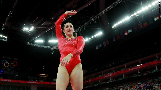 Jordyn Wieber of the United States waves after competing on the floor exercsise in the gymnastics event.
