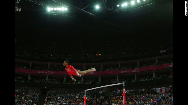 Gabrielle Douglas of the United States competes on the uneven bars in the gymnastics women's team final.