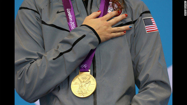 Gold medalist Allison Schmitt poses with her medal. 