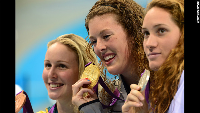 Gold medalist Allison Schmitt, center, silver medalist Camille Muffat of France, right, and bronze medalist Bronte Barratt of Australia smile on the podium after the women's 200-meter freestyle final on Tuesday. 
