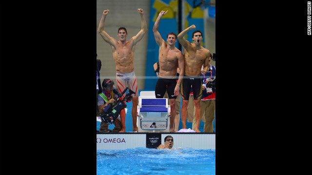 U.S. swimmers Ryan Lochte, center, Conor Dwyer, left, Ricky Berens, right, and Michael Phelps, in the water, react after their win.