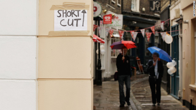 "Pranksters have plastered London with ""short cut"" signs, leading unsuspecting spectators to France."