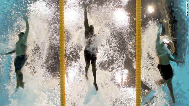 From left, Ahmed Husam of the Maldives, Mamadou Soumare of Mali and Beni Bertrand Binobagira of Burundi compete in the men's 100-meter freestyle heat Tuesday. See photos from <a href='http://www.cnn.com/2012/08/01/worldsport/gallery/olympics-day-five/index.html' target='_blank'>day five of the competition</a> from Wednesday, August 1.